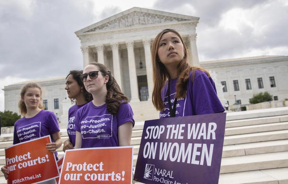 Young activists demonstrated at the Supreme Court as President Trump prepared to choose a replacement for Justice Anthony Kennedy, on Capitol Hill in Washington on Thursday.